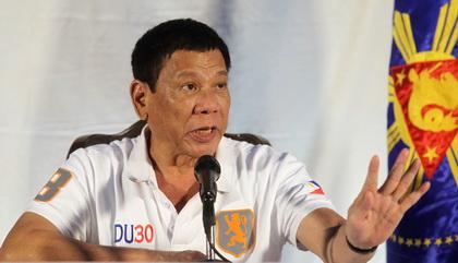 Philippine President Rodrigo Duterte speaks during a news conference in Davao